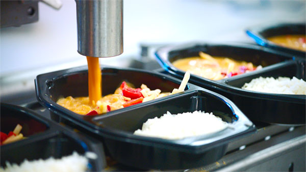 With the Micvac equipment all kinds of food can be handled and filled into trays